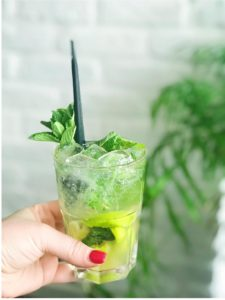 Hand holding A fresh Mojito from 12 beach road