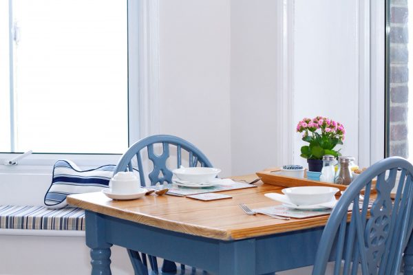 Blue table in breakfast room looking out over sea view