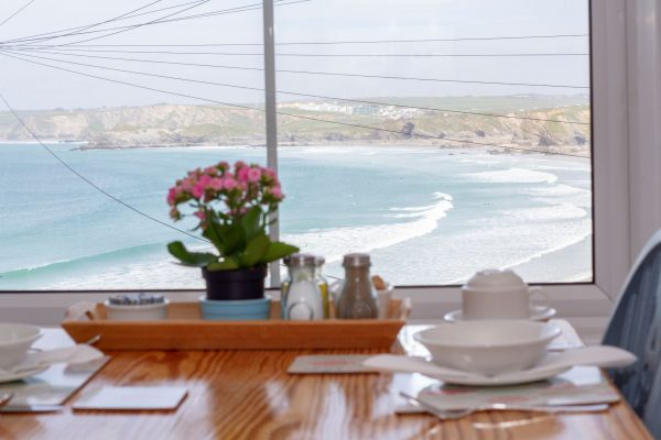 Window view from the breakfast room. blue sky and beach