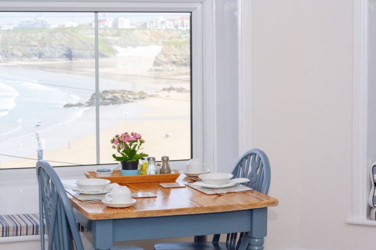 Breakfast room table with Towan Beach in the background