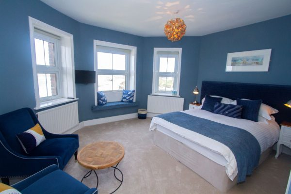 Fistral Suite, blue room with two blue chairs and coffee table