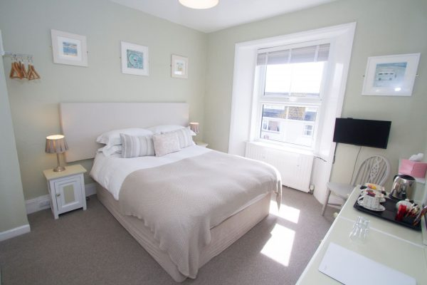 Great Western room, light green with white furnishings