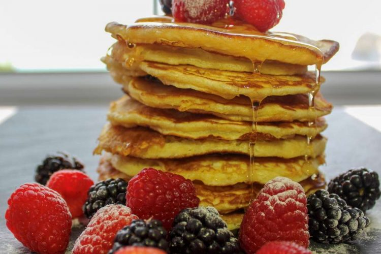 Our delicious American Style Pancakes, topped with fresh berries and maple syrup.